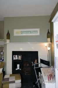 Ginger Tree reception area with original fireplace now used as decor