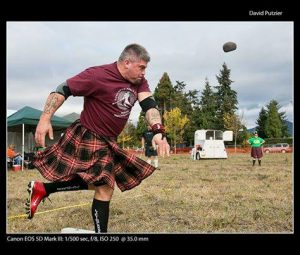 Guys in kilts compete in heavy athletics