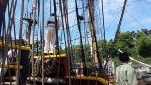 Tall ships crew works as a team to sail the vessle